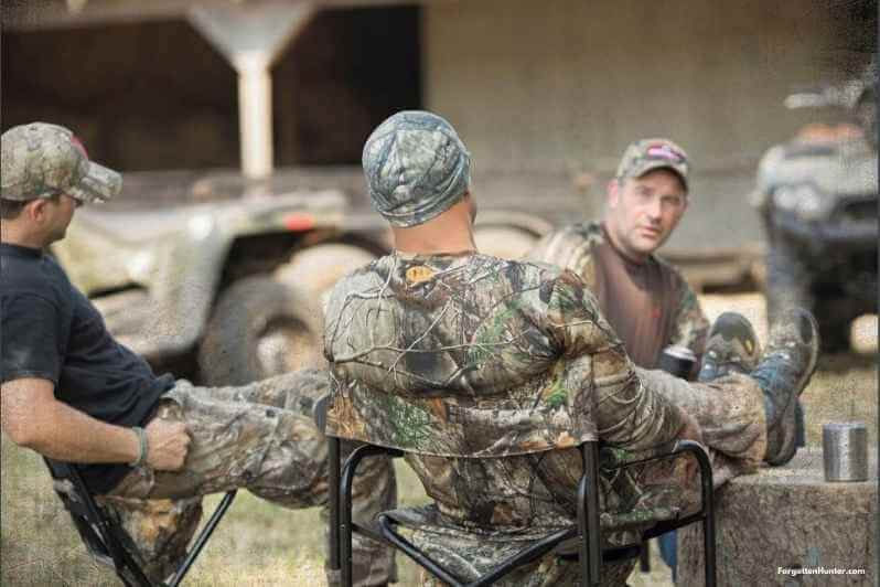Multiple Hunters Sitting on hunting chairs